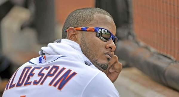 Jordany Valdespin watches the game from the dugout