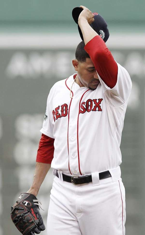 Franklin Morales of the Boston Red Sox wipes