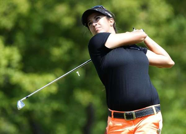 Gerina Piller watches her tee shot on the