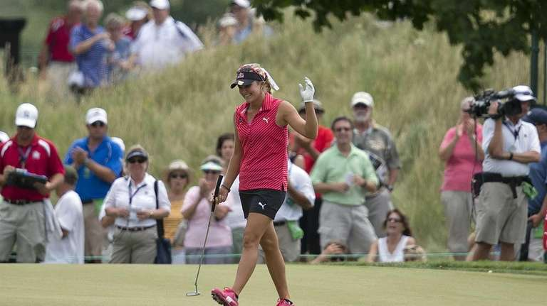 Lexi Thompson reacts after sinking a putt for