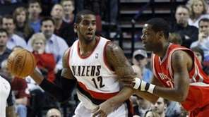 Portland Trail Blazers forward LaMarcus Aldridge, left, looks