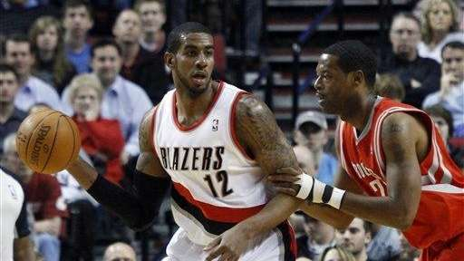 Portland Trail Blazers forward LaMarcus Aldridge, left, looks