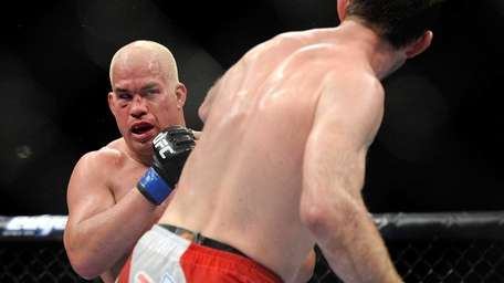 Tito Ortiz, left, and Forrest Griffin battle it