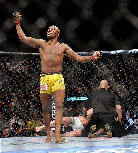 Anderson Silva celebrates after the referee stopped the