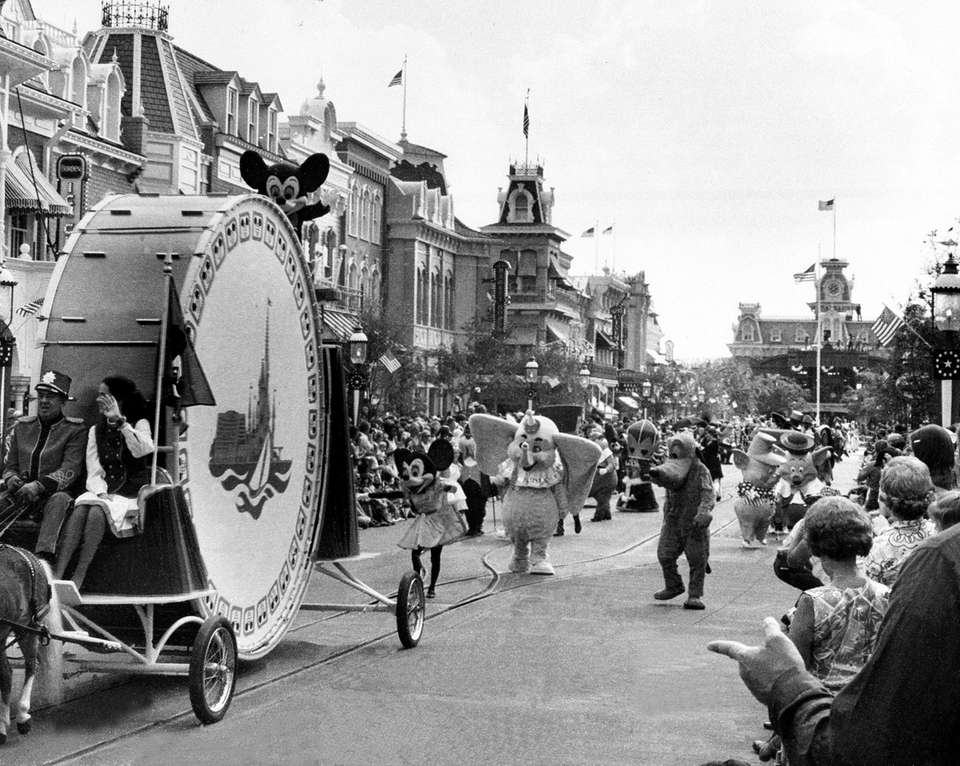 Mickey Mouse waves from atop a huge drum