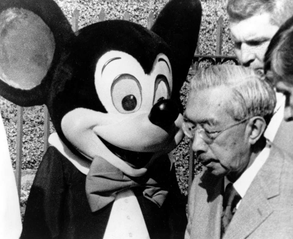 Mickey Mouse watches as Emperor Hirohito of Japan
