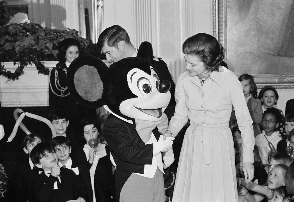 First lady Betty Ford and Mickey Mouse welcome
