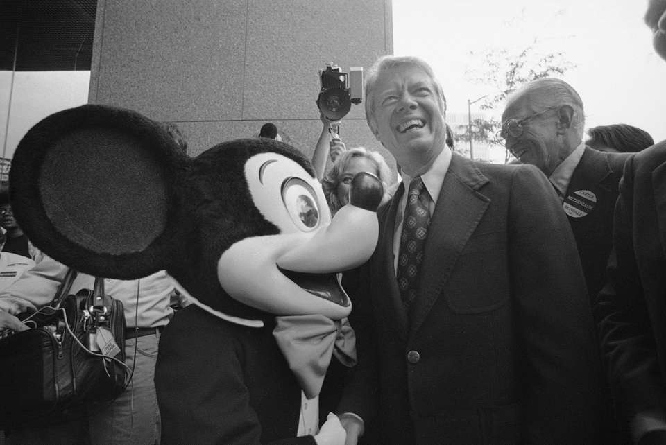 Jimmy Carter grins as he meets Mickey Mouse
