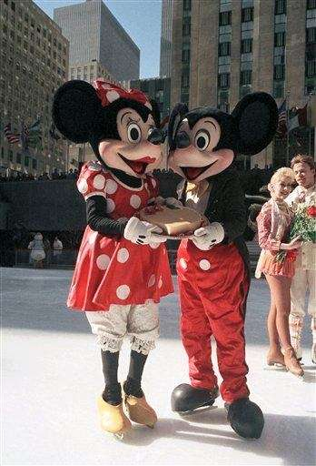 Disney characters Mickey and Minnie Mouse share a