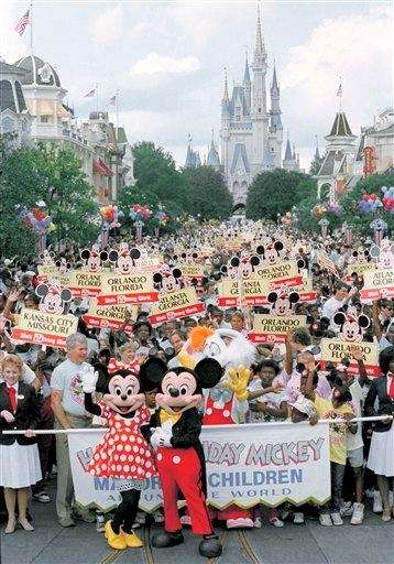 Mickey and Minnie Mouse lead a group of