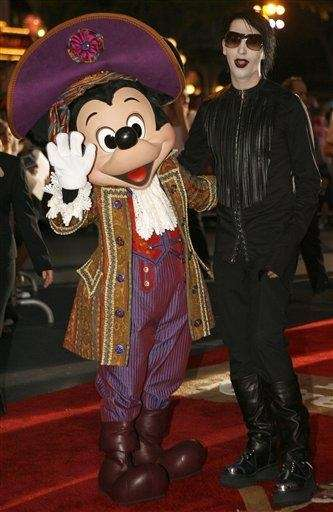 Musician Marilyn Manson, right, and Mickey Mouse pose