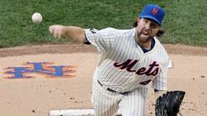R.A. Dickey pitches in the first inning against