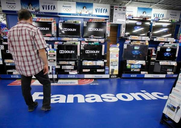 A man looks at a line of Panasonic