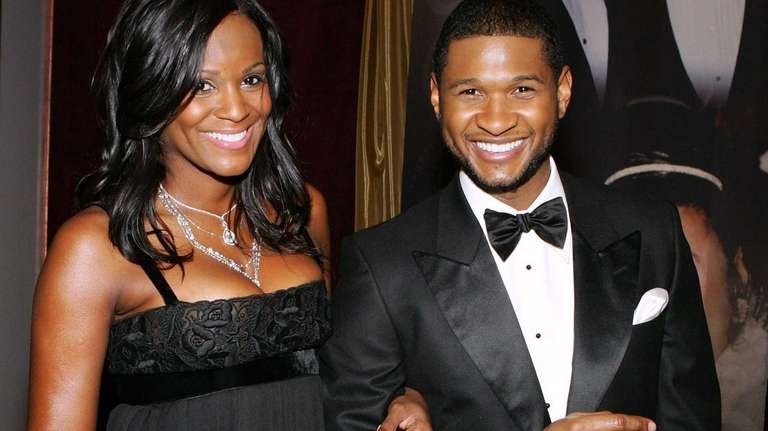 Usher Raymond arrives with Tameka Foster at the