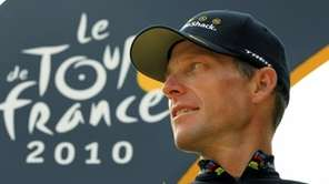Lance Armstrong looks back on the podium after