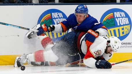 Leo Komarov of the Islanders collides with Keith