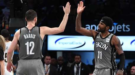 Brooklyn Nets guard Kyrie Irving, right, and forward