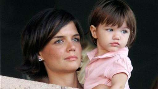 Katie Holmes and daughter Suri Cruise watch the