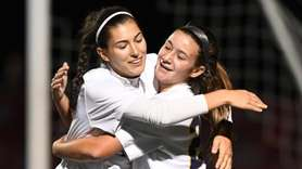 MassapequaÕs Gianna Savella, right, celebrates her goal with