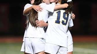 Massapequa players celebrate a goal against Syosset during