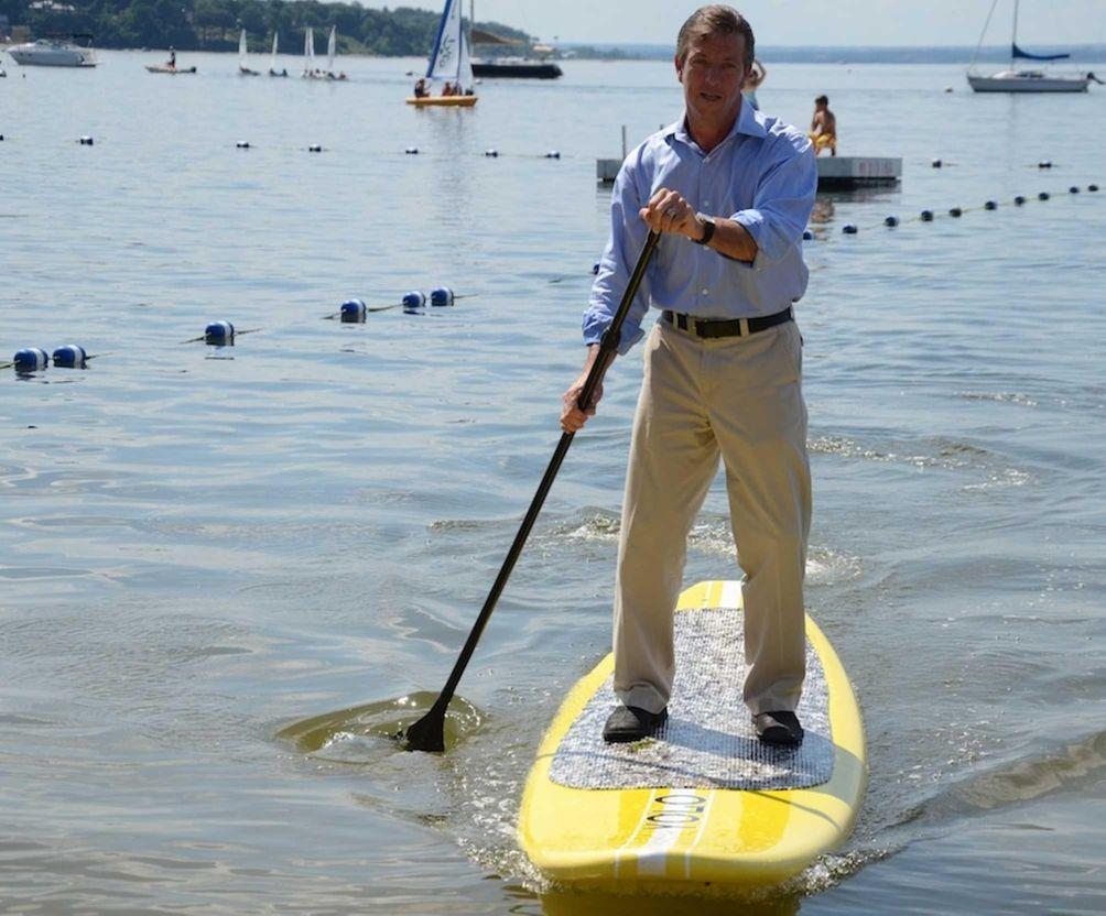 Wearing work attire, Sea Cliff Mayor Bruce Kennedy,