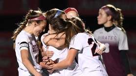 MacArthur players celebrate a goal against Mepham during