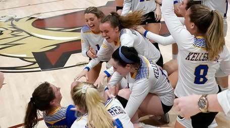 Members of the Kellenberg girls volleyball team celebrate