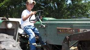Ten-year-old Jacob Mosbacher guides a tractor through a