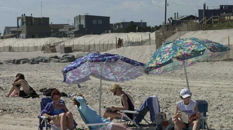 People enjoy the sun on the beach in