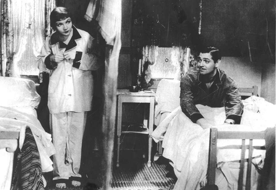 Claudette Colbert and Clark Gable, in a scene