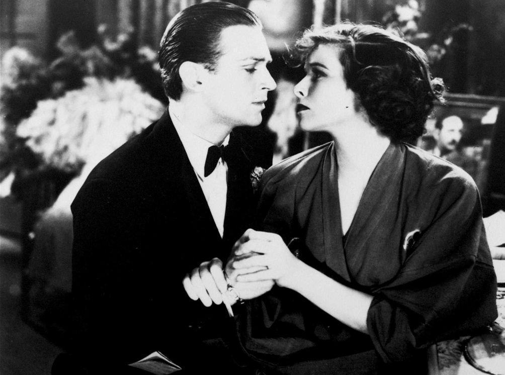 Douglas Fairbanks, Jr. and Katharine Hepburn, in a