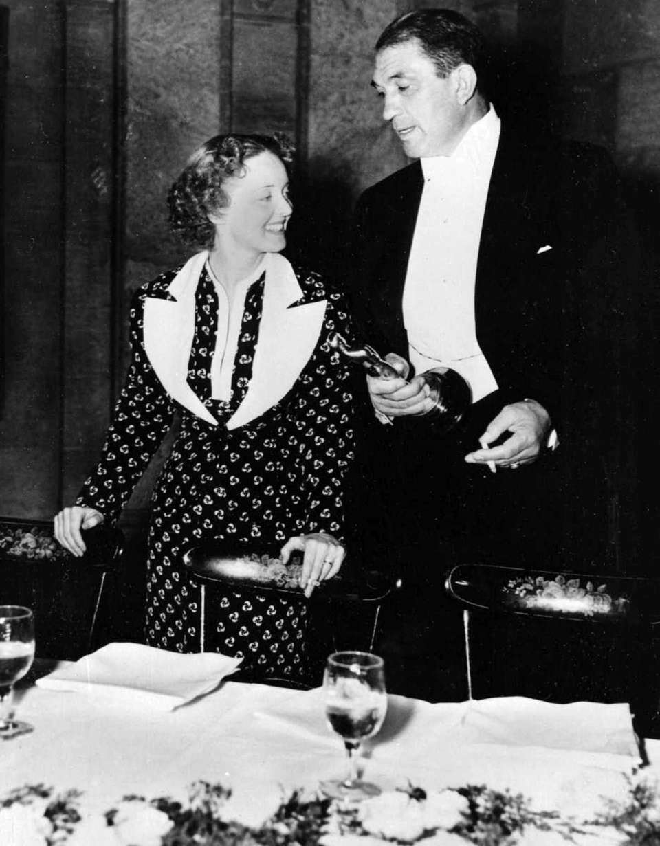 Bette Davis and Victor McLaglen are shown at