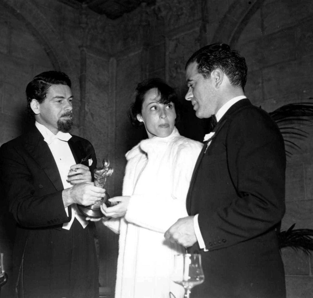 Oscar winners Paul Muni (holding statuette), Louise Rainer