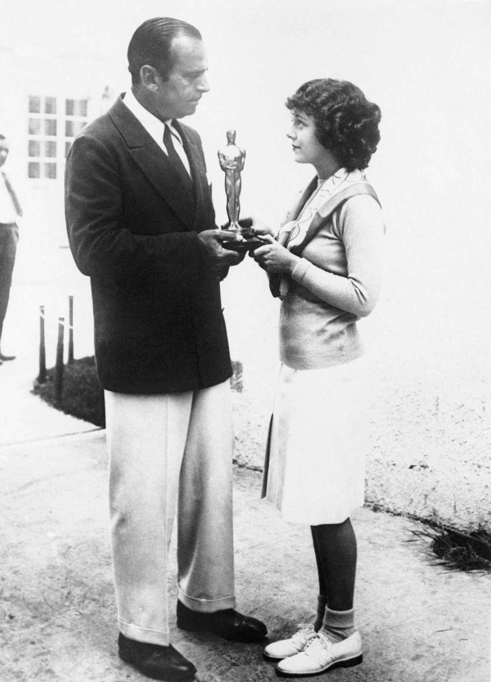 Actor Janet Gaynor (right), receiving the 1929 Academy