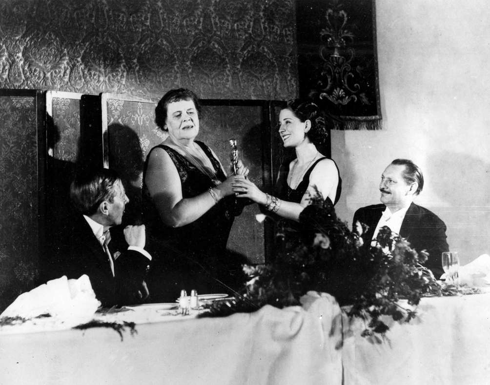 Actor Norma Shearer (right center), presents the 1932