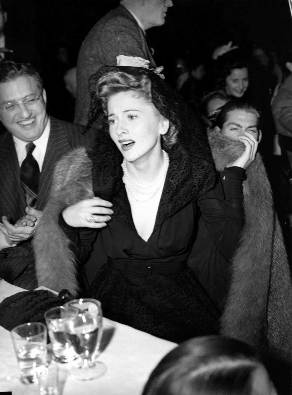 Actor Joan Fontaine, reacting as she wins the