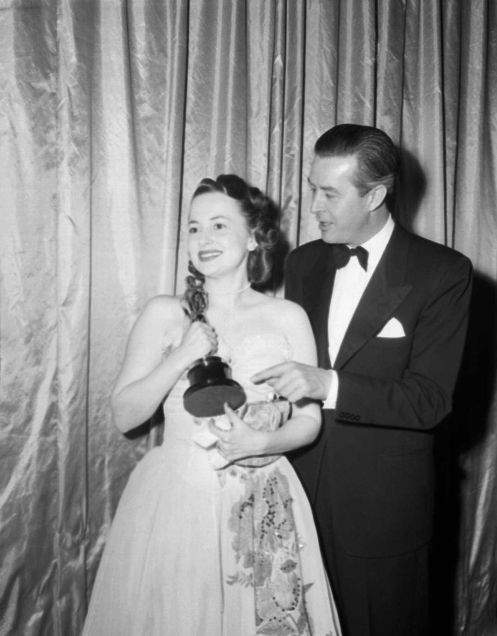 Olivia De Havilland (left) and Ray Milland, during