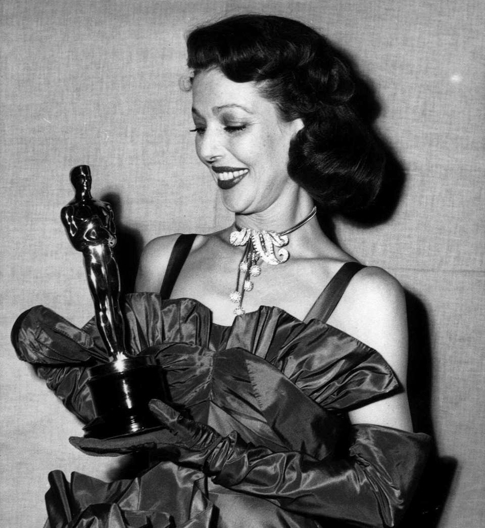 Actor Loretta Young, holding the Oscar statuette she