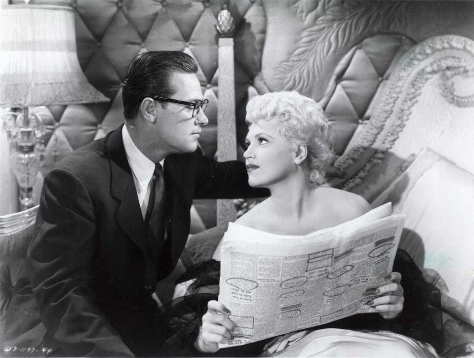 William Holden and Judy Holliday, in a scene
