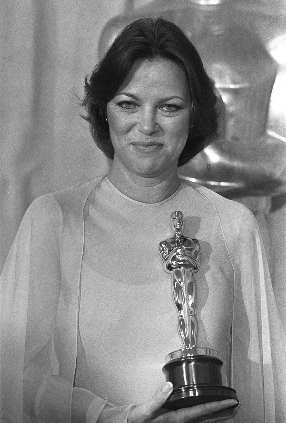 Actor Louise Fletcher, holding the Oscar statuette she