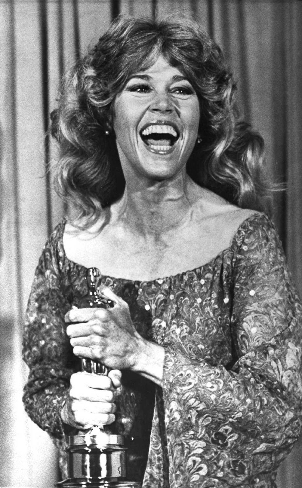 Actor Jane Fonda, holding the Oscar statuette she