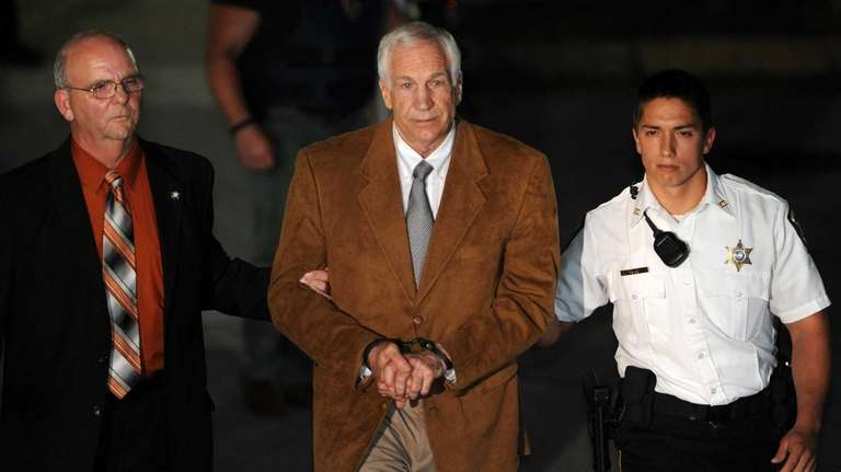 Jerry Sandusky leaves the Centre County Courthouse Friday,