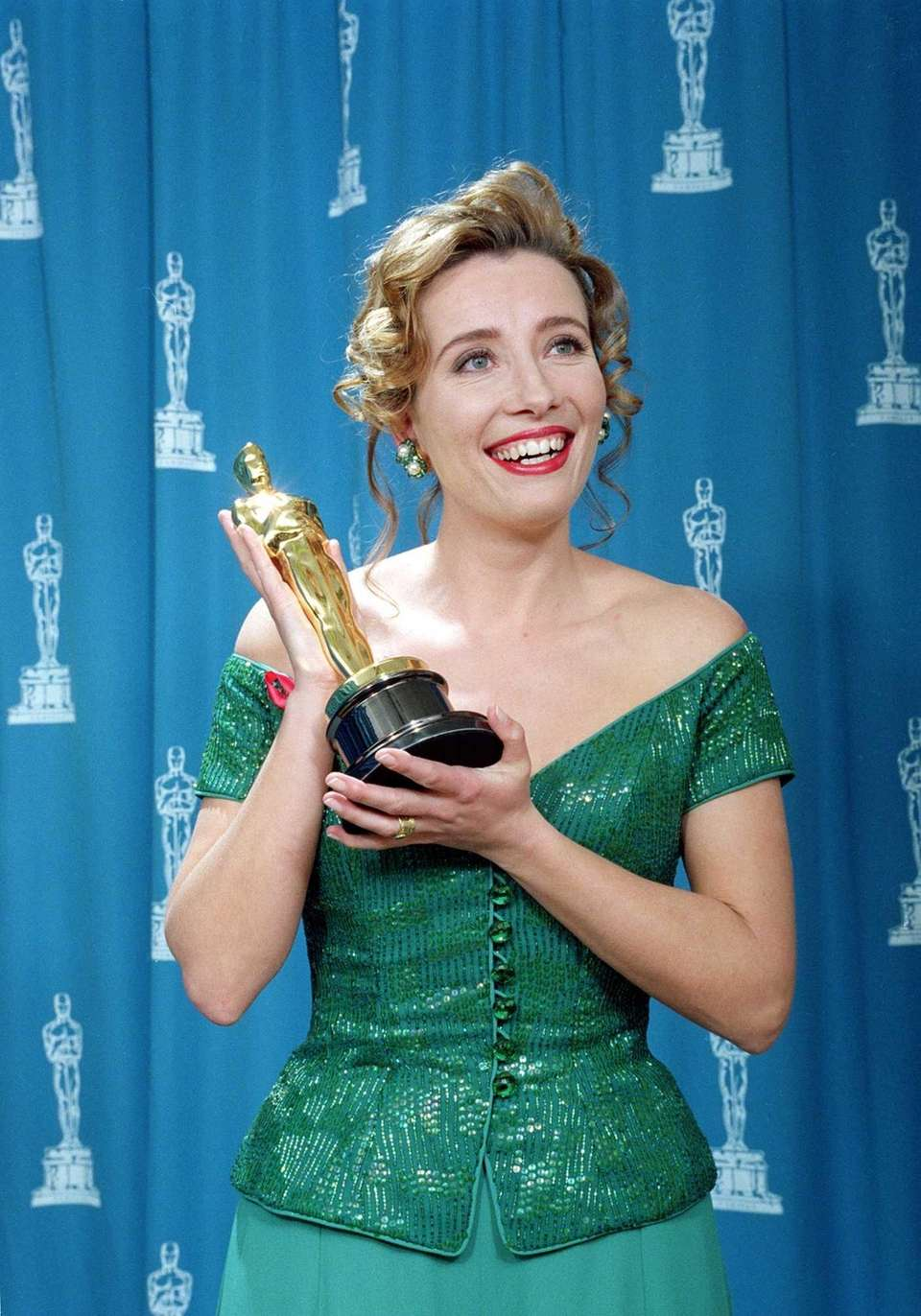 Actor Emma Thompson, posing with the Oscar statuette