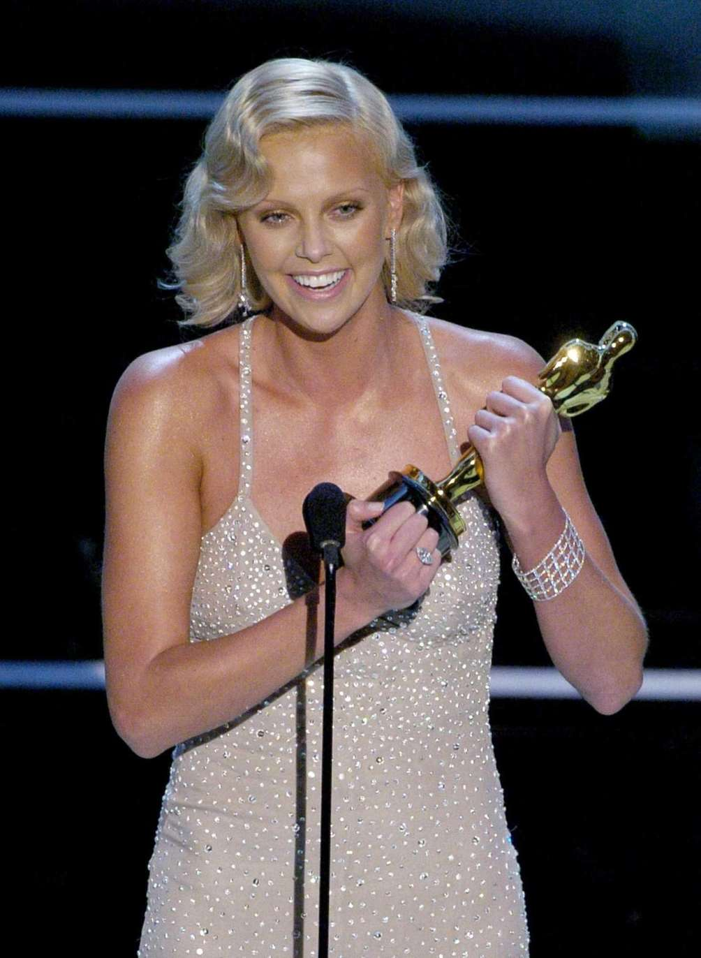 Actor Charlize Theron, accepting the Oscar statuette she