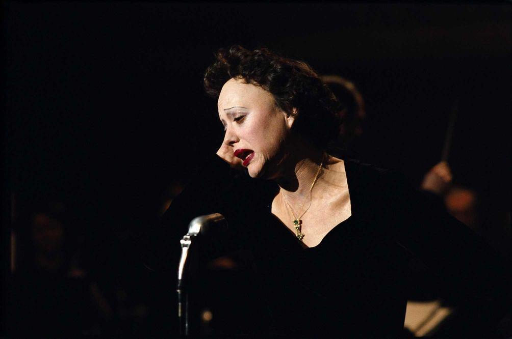 Marion Cotillard, portraying singer Edith Piaf in a