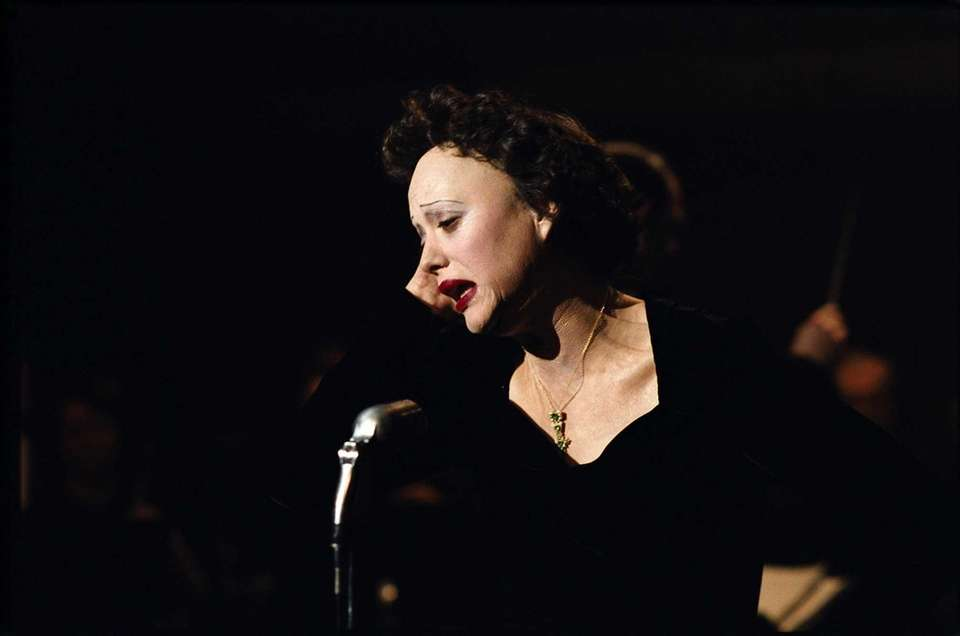 Marion Cotillard, portraying singer Edith Piaf in a