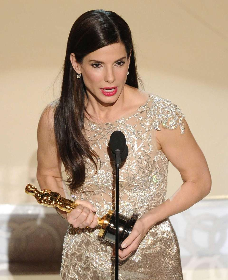 Actor Sandra Bullock, accepting the Oscar statuette she