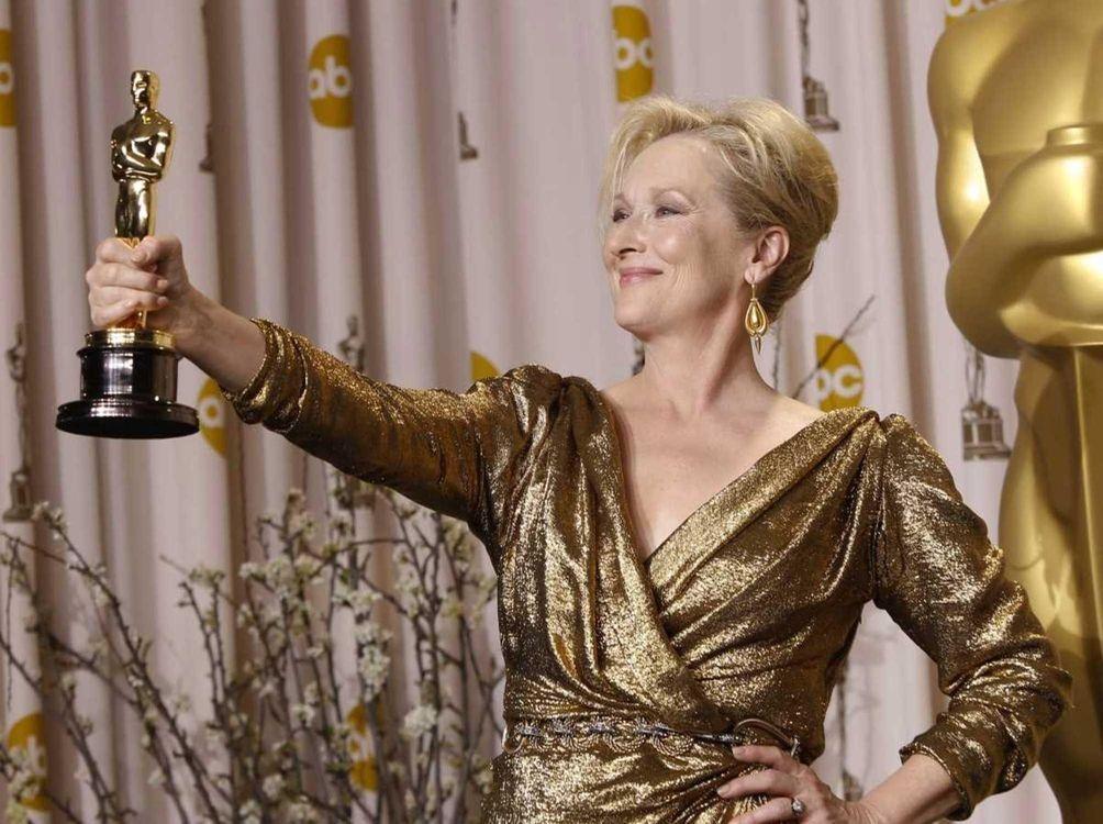 Actor Meryl Streep, posing with the Oscar statuette