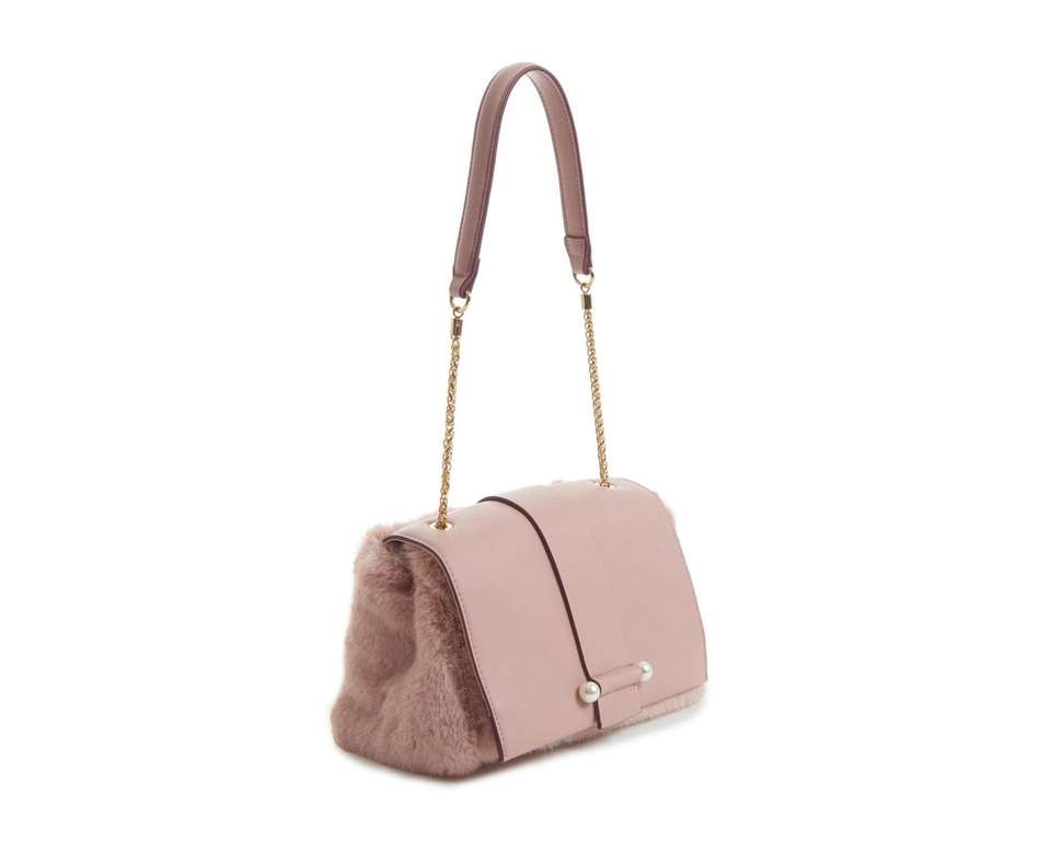 This fuzzy and fun crossbody bag features a