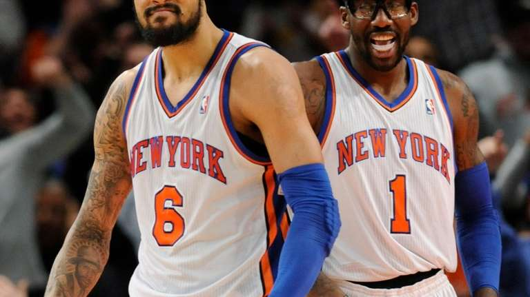 Knicks' Amar'e Stoudemire, right, smiles as Tyson Chandler